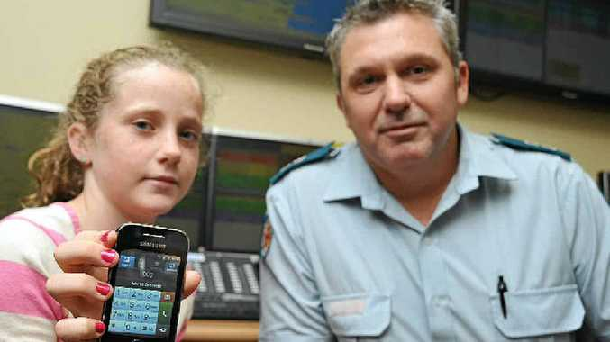 THE RIGHT CALL: Claudia Stevens, 10, shows the importance of kids being able to use the 000 service effectively, pictured with her father Mark Stevens, the Sunshine Coast Ambulance Operations Centre supervisor.