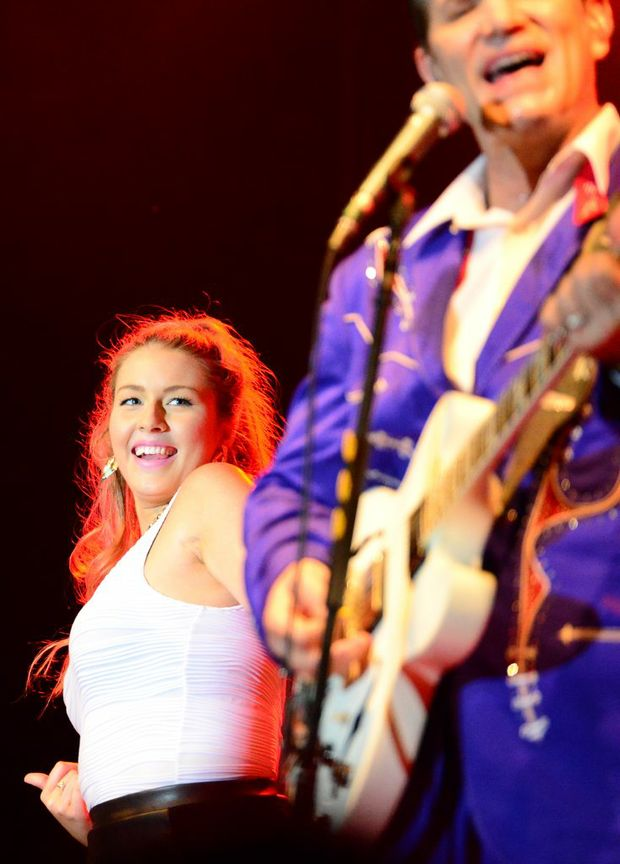 Beat reporter Amy Haydock gets picked from the crowd to dance with Chris Isaak at the Beyond the Sun Tour' at The Great Western Hotel, Rockhampton. Photo Sharyn O'Neill / The Morning Bulletin