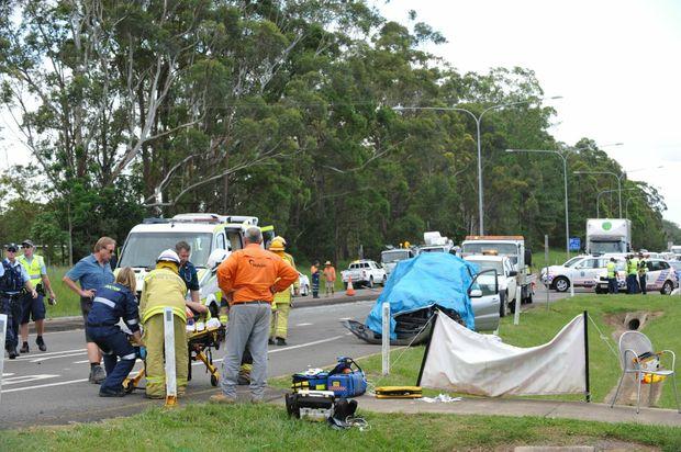 Scene of a double fatal crash along Steve Irwin Way, Glasshouse Mountains, involving three cars and a truck. Photo: Iain Curry / Sunshine Coast Daily