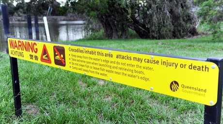 A crocodile warning sign at the Lamington Bridge.