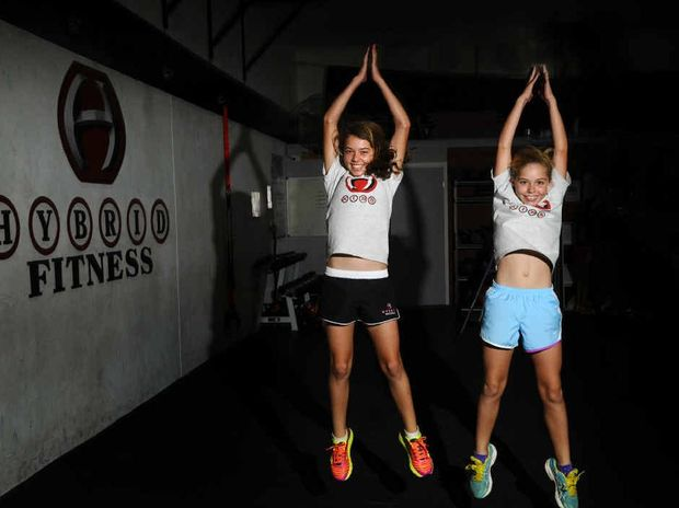 500M OF PAIN: Abby Harley, 12, and Laura Harley, 10, get some practice in ahead of the Burpee 500 fundraiser for Camp Quality. Photo: JoJo Newby
