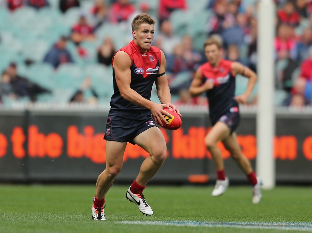 Jack Viney of the Demons runs with the ball during the round one AFL match between the Melbourne Demons and Port Adelaide Power at the Melbourne Cricket Ground on March 31, 2013 in Melbourne, Australia.