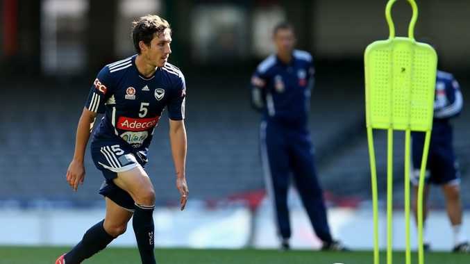Mark Milligan of the Victory controls the ball during a Melbourne Victory A-League training session at Etihad Stadium on April 4, 2013 in Melbourne, Australia.
