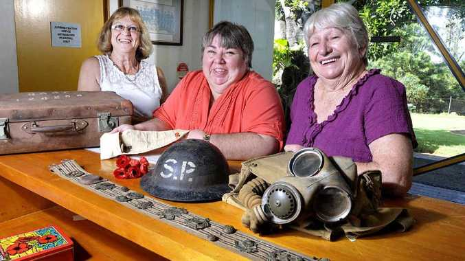 WAR RELICS: Vivienne Harper (left) with Linda and Jocelyn Doherty look through some of the Anzac memorabilia on show at the Cooneana Homestead.