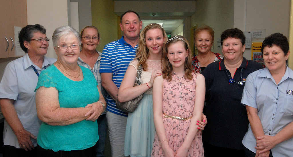 REUNION: Current and former Mackay Base Hospital staff (from left) Fay Curtis, Joy Gray, Justine Collins, Cheryl Willersdorf, Kerry Topping and Biddy Don catch up with Graham, Robyn and Charlotte Blowers.