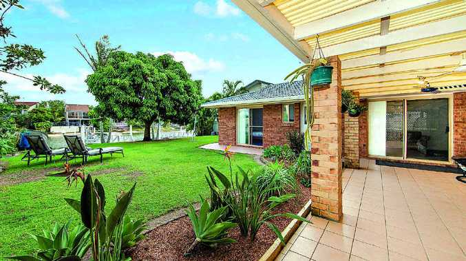26 Carrothool Pl is a large three- or four-bedroom home on the waterfront in Mooloolaba.