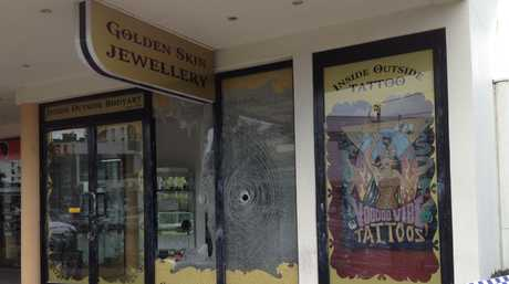 Police are investigating after shots were fired into a Brisbane Rd business at Mooloolaba.