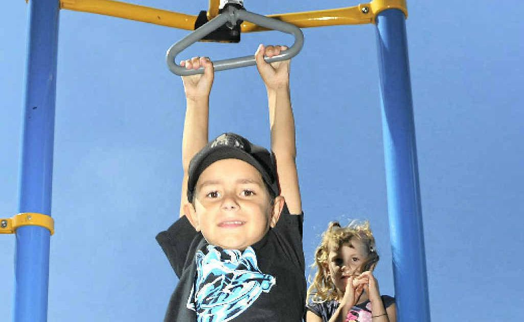 OUT AND ABOUT: Jhett Squire, 6 makes the most of the sunny school holidays at the Marina Playground, Gladstone.