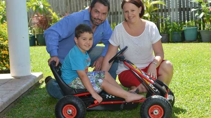 Harry Clews with parents Andrew and Belinda. Photo Peter Holt / Daily Mercury