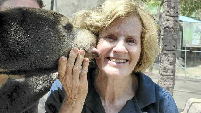 Mary Hutton gets a kiss from one of her beloved bears.