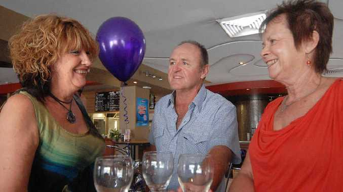 Cheeky Drinks' members Sue Anderson, Jim Kirchener and Julie Reardon with the purple balloon symbol.
