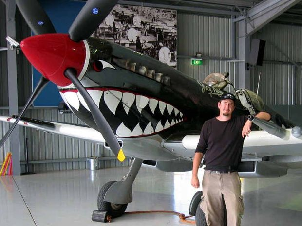 CHILDHOOD DREAMS: Toowoomba film maker Simon Van Der Spoel with one of the Spitfires featured in his documentary.