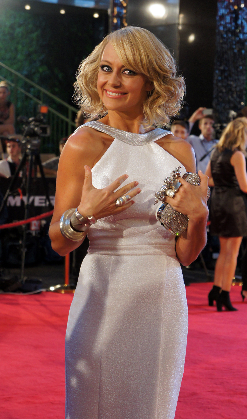 2013 Logies co-host Shelley Craft glitters in white and silver.