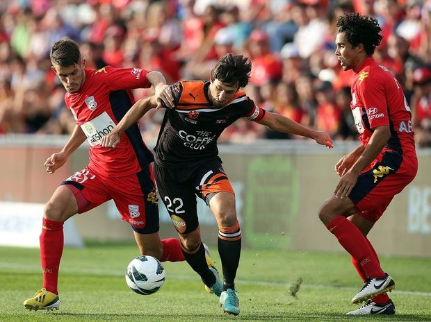 Dario Vidosic (L) of Adelaide competes with Thomas Broich (C) of Brisbane during the A-League Elimination Final between Adelaide United and Brisbane Roar at Hindmarsh Stadium on April 7, 2013 in Adelaide.