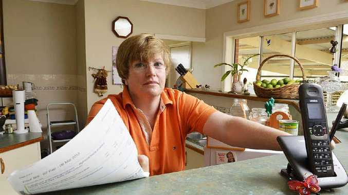 STILL PAYING: Jo Culbertson's phone has been out of order for eight weeks and Telstra is still charging her for the service.