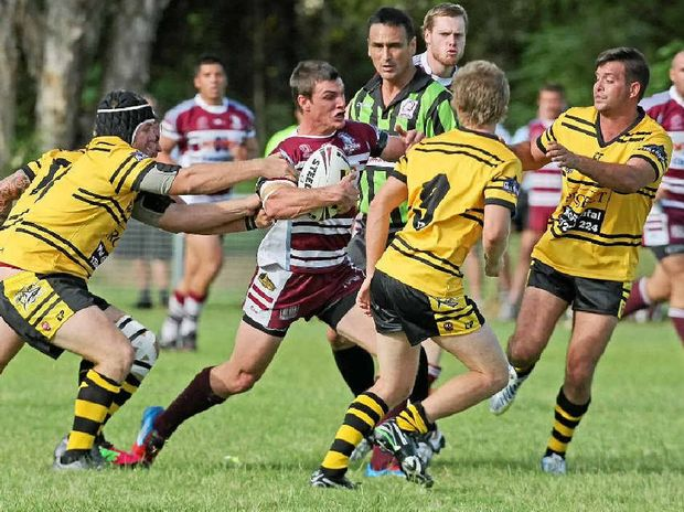 Kawana Dolphins player Tyson Teys takes the ball up against the Caloundra Sharks.