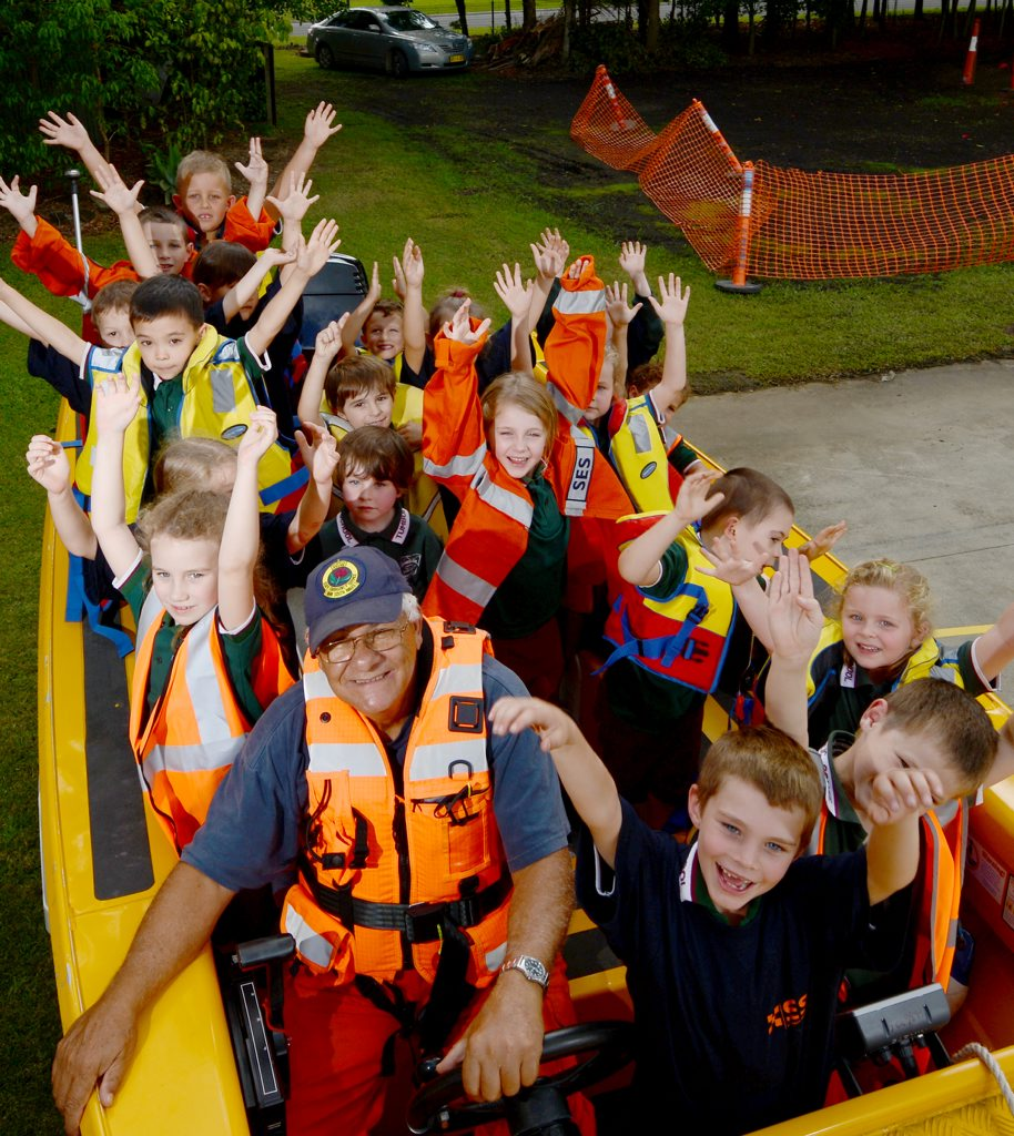 SES Controller Chris Chrisostomos gives Tumbulgum public School students a taste of what it is like in the rescue boat.