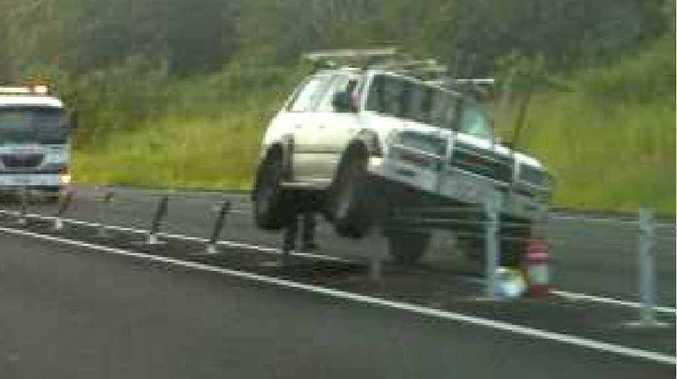 The driver of a four wheel drive mounted a high tension steel rope barrier separating traffic on the Bruce Hwy, after he blacked out from low blood sugar on Monday.