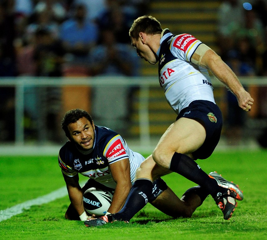 Matt Bowen of the Cowboys scores a try while team mate Brent Tate celebrates during the round six NRL match between the North Queensland Cowboys and the Melbourne Storm at Dairy Farmers Stadium on April 8, 2012 in Townsville, Australia.