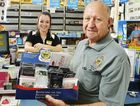 BUY LOCAL: Ipswich Railway RSL sub branch president Ray Watherston hands badges to North Ipswich Newsagency staff member Brianna Shaw.