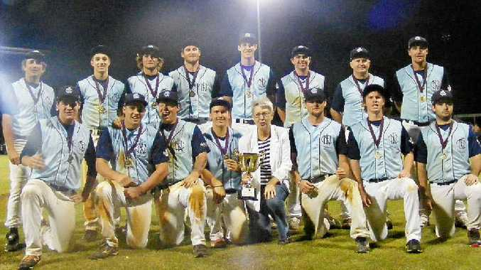 CHAMPIONS: FNC celebrates with Lismore City Council mayor Jenny Dowell after taking this year's Baseball Queensland Under-23 state title.