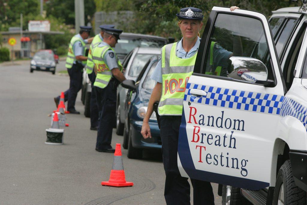 Traffic police conduct random breath testing.