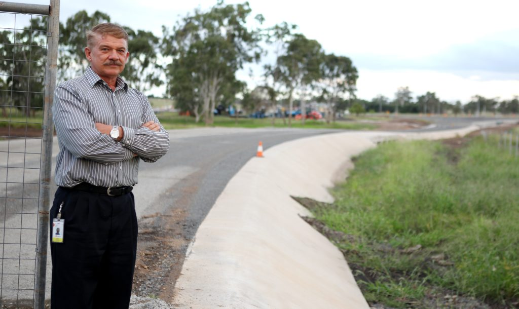 Stephen Bell near the new road works he says will cause more flooding. Photo Allan Reinikka / The Morning Bulletin