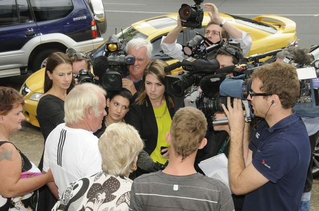 Trevor Hilton leaves the coronial inquest to be greeted by the media.