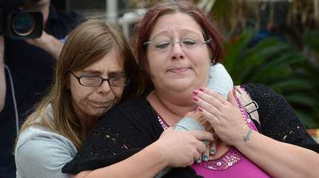 Debbie Sneddon (left), close friend of murdered nurse Wendy Evans, hugs Michelle Tuifufu (right), sister of Wendy Evans as they leave the Toowoomba courthouse.