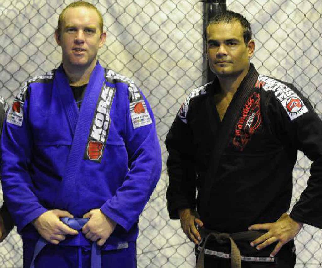 Gympie Brazilian Jiu-Jitsu coach Rex Carney in the ring with mentor and black belt trainer, Ryan Dunstan.