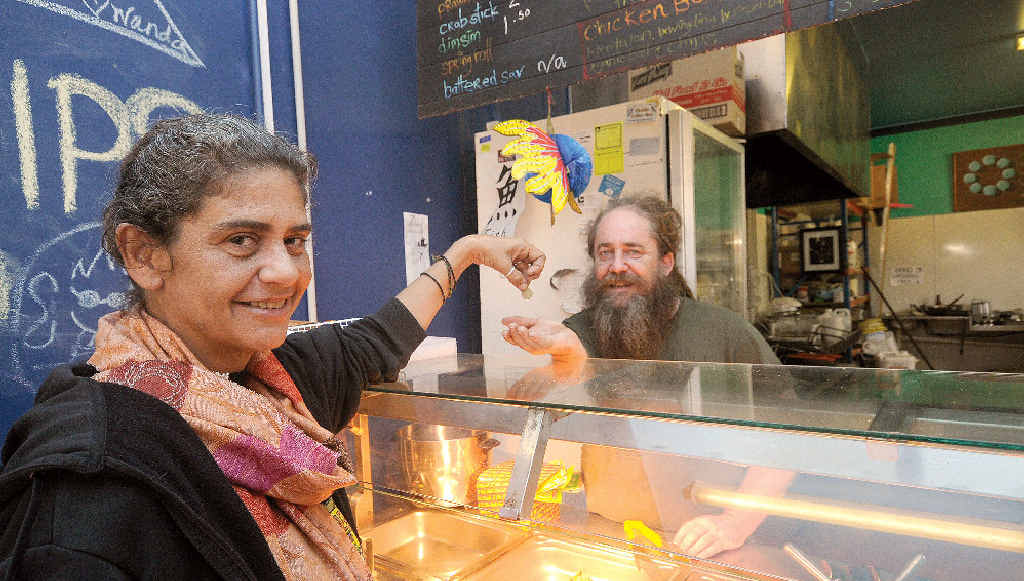 STONE FREE: Owner of Nimbin Stoned Fish, Justin Smith, pictured with Peta Johnson of Nimbin making a donation. Mr Smith is offering suspended meals at his cafe.