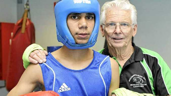 RISING TALENT: Teenage boxer Jade Cook, of Goonellabah, with his coach Arthur Maloney.