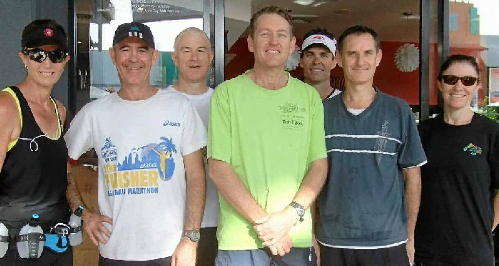 2013 Canberra Marathon competitors Linda McFadzen, Glenn Baker, Martin Lambert, Tim Magoffin, Mark McFadzen, John Turner and Karen Baker.
