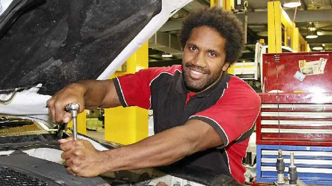 AT WORK: Co-captain of the Mackay Cutters Jardine Bobongie works during the day as a mechanic and trains at night for the Cutters.