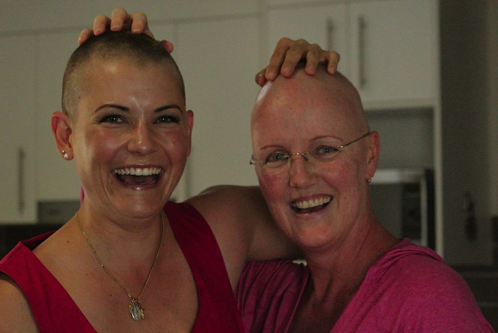 Erica Smith (left) has given up her locks to support her close friend Lia Halsall (right), and to raise funds for The Wesley Hospital Kim Walters Choices Program. Photo: Contributed (Samantha Ashen)