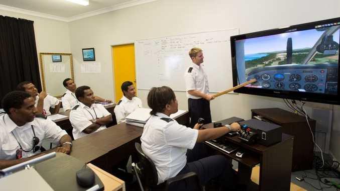 Matt Loretan of Professional Pilot Training runs the Air Niugini pilots through a flight simulation.