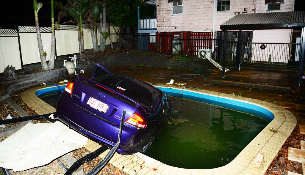 CAR WASH: A driver crashed his car through a fence and into a pool on the corner of Tudor and Challinor Street in West Ipswich.