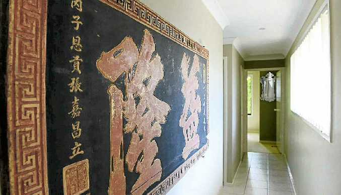 In the hall is a Chinese wood panel that dates from 1492. This piece was bought by Victoria in Yogyakarta.