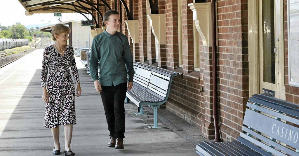 SPEEDY TRAINS: Federal MP Janelle Saffin with work experience student Harry Gregg walk the platform of Casino Railway Station.