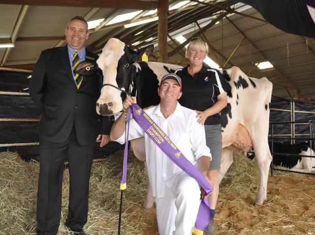 """With Champion Holstein Cow """"Leader Mrsam Shania"""" are (from left) RASQ Dairy Chairman Wayne Bradshaw and Travis and Melissa Deans from Leader Holsteins."""