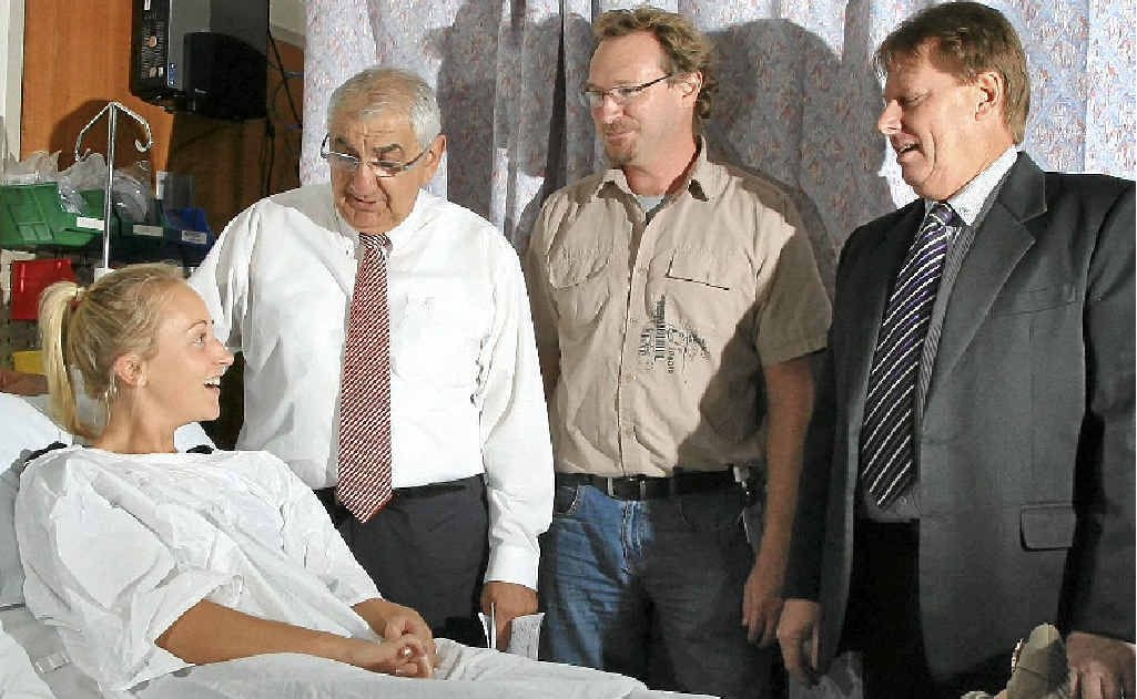 Lismore MP Thomas George, Dr Paul Fischer and Northern NSW Local Health District acting capital works manager Bob Miller discuss the new plans with Abby Evans.