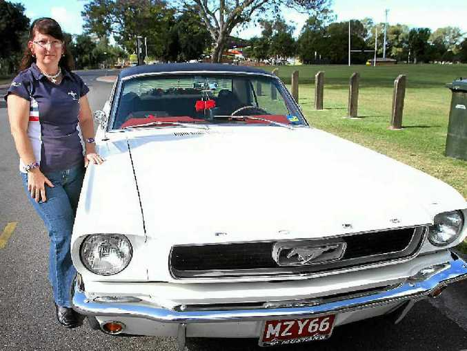 Annette Ferguson, with her 1966 Mustang Coupe, says drivers must always be aware of what is around them on the road.