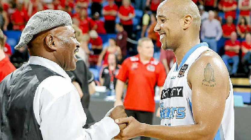 NBL legend Cal Bruton congratules his son, CJ.