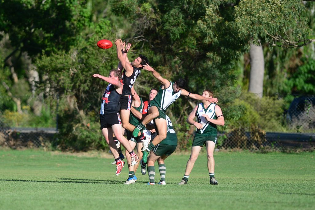 AFL Capricornia round one Gladstone Mudcrabs vs BITS Saints at Clinton Park. All in for the ball.