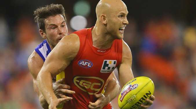 Gary Ablett of the Suns looks to handball during the round three AFL match between the Gold Coast Suns and the Brisbane Lions at Metricon Stadium on April 13, 2013 in Gold Coast, Australia.