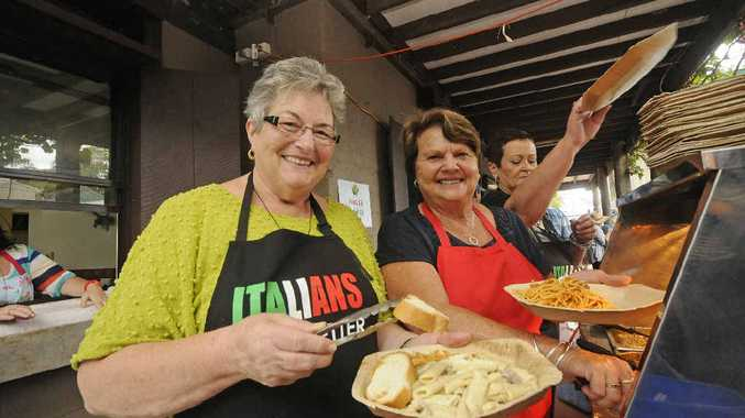WINNING FOOD: Julie Denardi of Lismore and Faye Sudiro of Kyogle serving up some great Italian food at the Carnivale Italiano at New Italy yesterday.