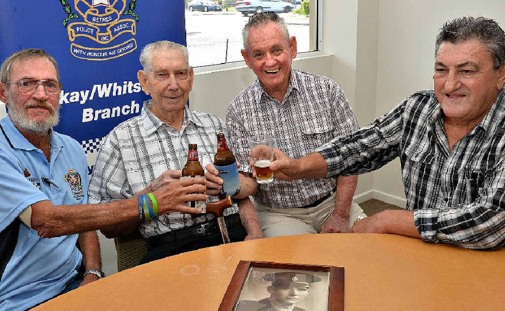 Tom Butcher (second from left) celebrates his 90th birthday and is toasted by (from left) Dennis Doring, Col Duncan and Les Campbell.