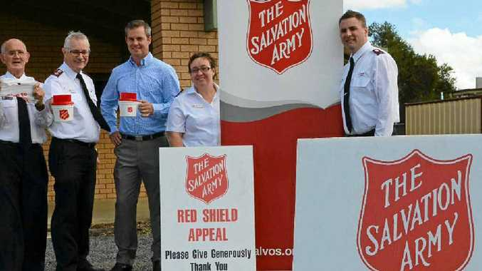 Aux-Captain Terry Cantrill, Major Neil Dickson, David Cassels and Warwick Salvation Army lieutenants Lydia and Steve Spencer gear up for the Red Shield Appeal.