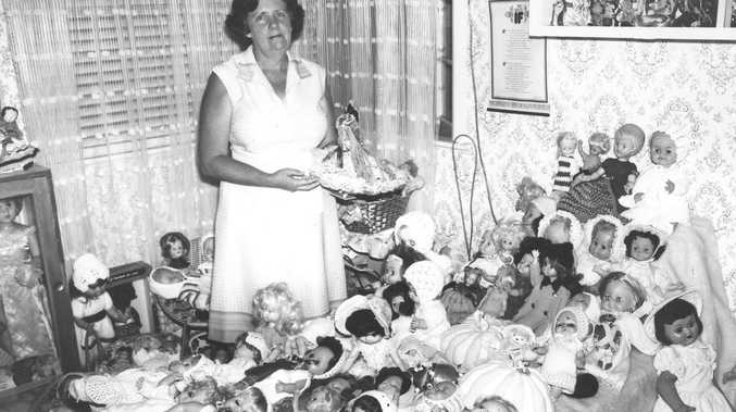 The lady with lots of dolls.