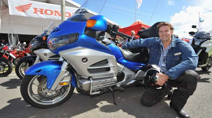 Max Spencer from Bribie Island smiles after his test ride on a new Honda Goldwing GL 1800 at the Ulysses AGM in Maryborough.